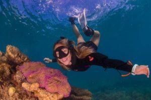 Freediving traveller exploring the reef.