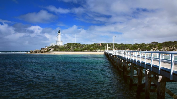 Bridge leading towards an island with a lighthouse, Queenscliff.